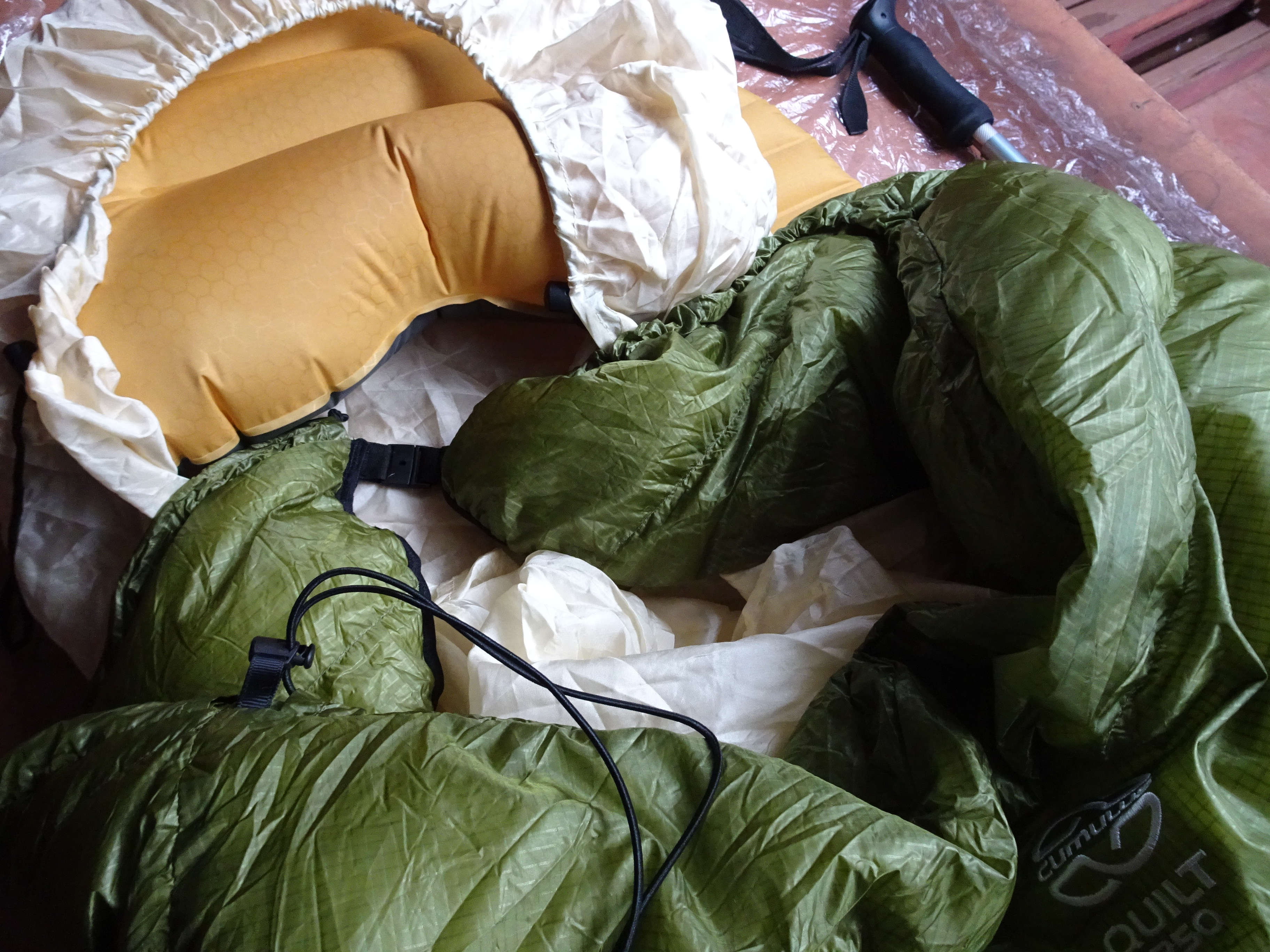 Using a bungee cord and tanka you can tie the quilt around your neck